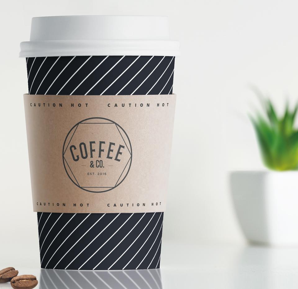 Coffee & Co. logo on a coffee cup sleeve
